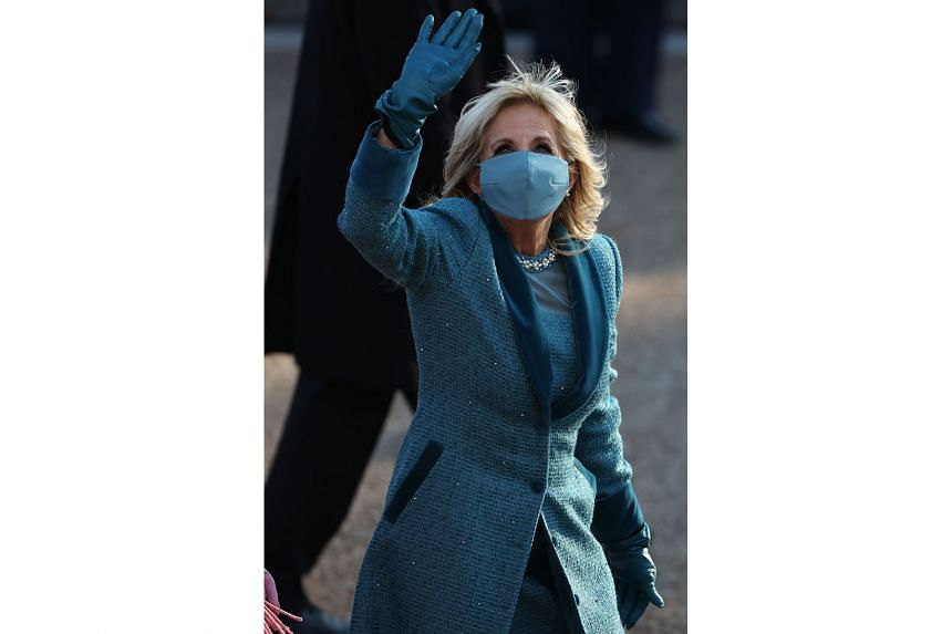 First Lady Jill Biden greeting people after the inauguration. Dr Biden, who has a doctorate in educational leadership, will continue teaching writing at Northern Virginia Community College, where she taught full time as second lady previously. PHOTO: