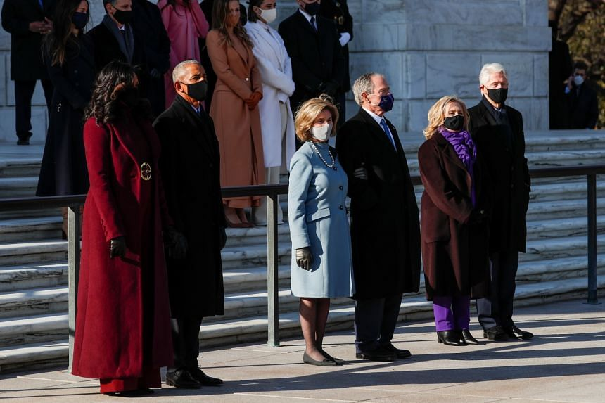 From far left: Former US president Barack Obama with his wife Michelle Obama, former president George W. Bush with his wife Laura Bush, and former president Bill Clinton with his wife, former secretary of state Hillary Clinton, at the Arlington Natio