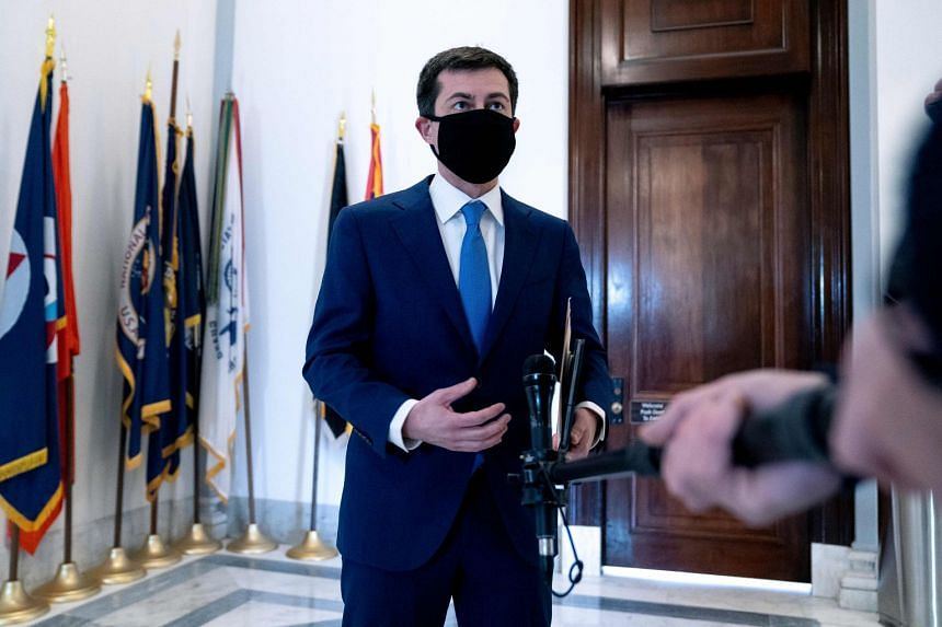 Pete Buttigieg speaks to the press after a confirmation hearing at the Senate in Washington.
