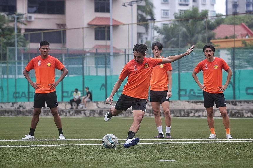 Shahril Ishak shooting at training as fellow new signings (from left) Khairul Nizam, Kaishu Yamazaki and Tomoyuki Doi await their turn at St Wilfrid Field.