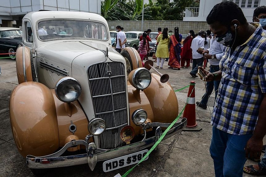 DRIVE DOWN MEMORY LANE: Vintage vehicles take the spotlight at a heritage car show in Chennai, India, including a 1914 Benz 8/20 PS and a 1936 Plymouth.