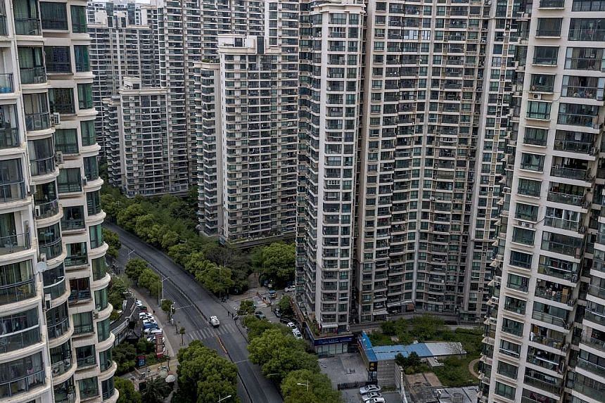 Families can own two homes in Shanghai. Under the new rule, the number of homes owned by people who have been divorced for under three years will be based on the total they had when they were still married.