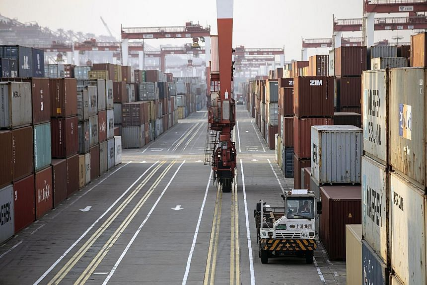 US President Joe Biden said in his inaugural address this week that America will repair its alliances and re-engage with the world. He has also said foreign policy must make sense to American voters. Above: Shipping containers at a port in Shanghai.