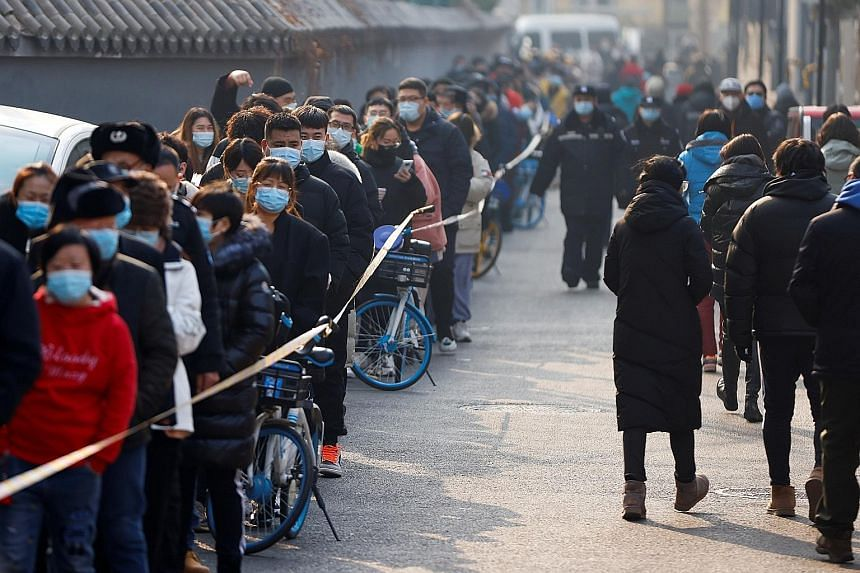 People lining up to get tested for Covid-19 in Beijing yesterday, as China battles its worst outbreak of the disease since March. Some districts in the capital launched mass testing following several consecutive days of new cases in the city, with lo