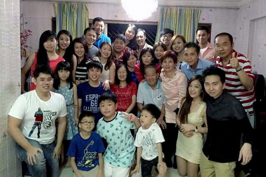 Hair salon owner Elsa Lim (in black and white top) and her family during a Chinese New Year gathering in 2016. She says that this year, instead of physical visits, they would make do with phone or Zoom calls.