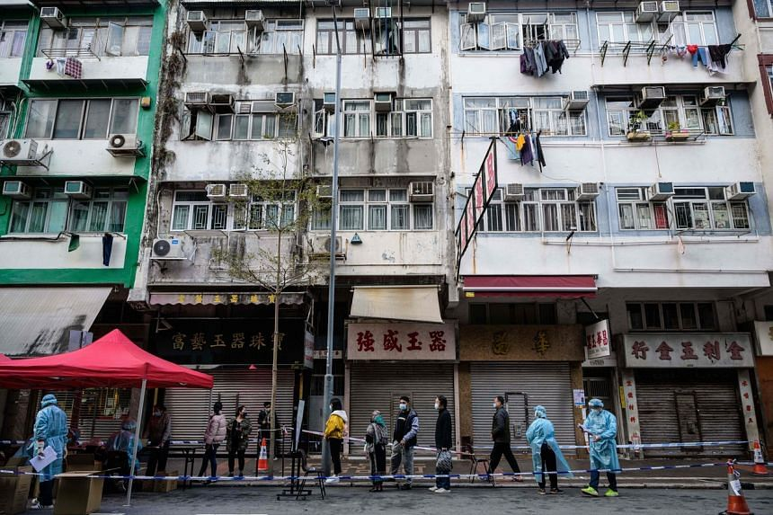 Residents queue up for a mandatory Covid-19 test in the Jordan area of the Yau Tsim Mong district of Kowloon.