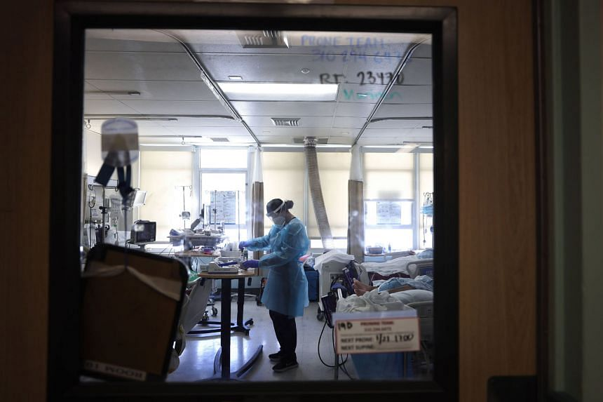 Covid-19 patients in a makeshift intensive care unit in a hospital in Torrance, California, on Thursday. President Joe Biden's administration will act to mobilise more medical teams to get shots in people's arms and to increase vaccine supply, but ma