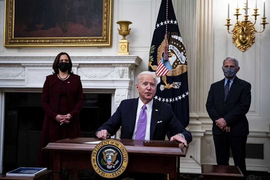 United States President Joe Biden speaking about his administration's response to Covid-19 at the White House on Thursday. He is joined by Vice-President Kamala Harris and National Institute of Allergy and Infectious Diseases director Anthony Fauci.
