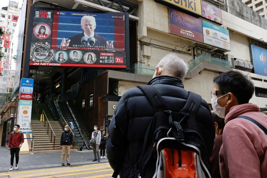 A big screen in Hong Kong showing US President Joe Biden after his inauguration this week. Beijing hopes he will reverse sanctions on Hong Kong and Chinese officials for railroading the national security law in the territory.