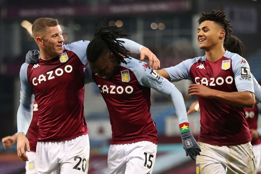 Bertrand Traore (centre) celebrates with teammates Ross Barkley (left) and Ollie Watkins after scoring Villa's second goal.