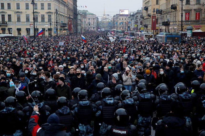 Law enforcement officers stand in front of participants during a rally in Saint Petersburg, Jan 23, 2021.