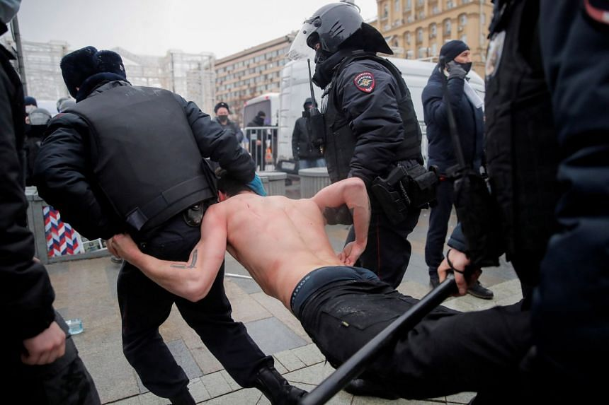 Law enforcement officers detain a man during a rally in Moscow, Jan 23, 2021.