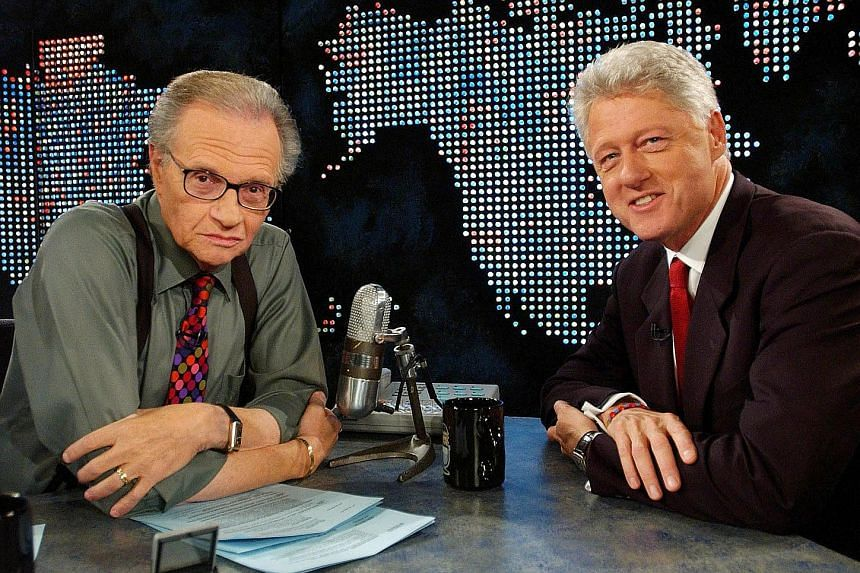 Broadcast interviewer Larry King (left) with former US president Bill Clinton on CNN talk show Larry King Live, in New York in 2002. Mr King interviewed every sitting US president from Mr Gerald Ford to Mr Barack Obama.