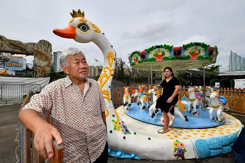 Mr Lee Woon Chiang, founder of Uncle Ringo, with his daughter Joyce at their fun fair at the Social Innovation Park in Punggol on Friday. Their plans last year to take a travelling circus to the heartland and to hold large-scale carnivals in China ha