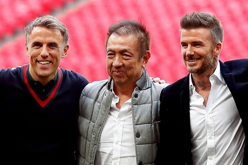 Phil Neville (left) and David Beckham, pictured with Singaporean businessman Peter Lim, are reunited at MLS team Inter Miami. PHOTO: REUTERS