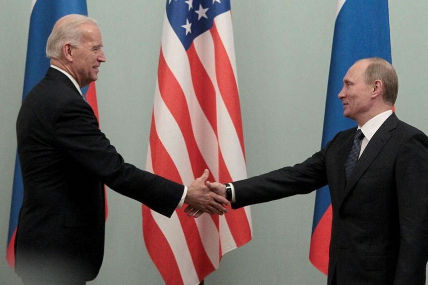 Then Russian PM Vladimir Putin (right) greeting then US Vice-President Joe Biden in Moscow, on March 10, 2011.
