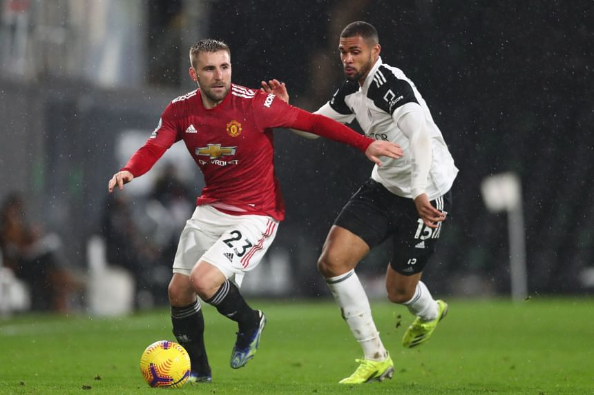Manchester United's English defender Luke Shaw (left) vies with Fulham's English midfielder Ruben Loftus-Cheek during the English Premier League football match at Craven Cottage in London, on Jan 20, 2021.