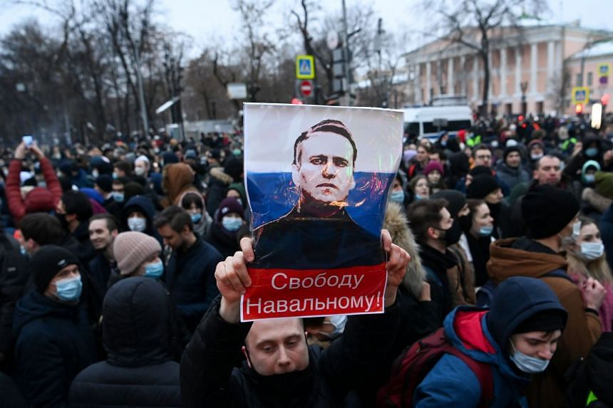 Protesters march in support of jailed opposition leader Alexei Navalny in downtown Moscow on Jan 23, 2021.