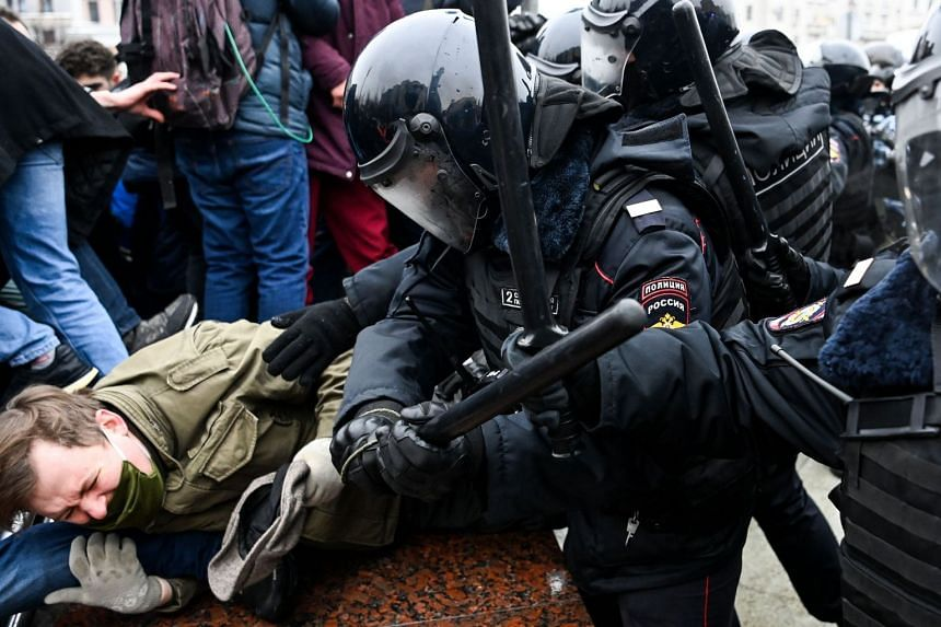 Protesters clash with riot police during a rally in downtown Moscow on Jan 23, 2021.