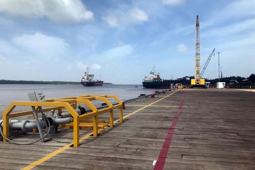 Vessels carrying supplies for an offshore oil platform operated by Exxon Mobil at the Demerara River, south of Georgetown, Guyana, on Jan 23, 2020.