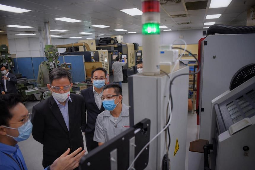 Trade and Industry Minister Chan Chun Sing during a visit to precision engineering company Univac on Jan 25, 2021.