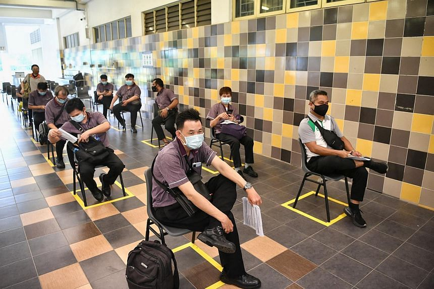 Land transport workers waiting to register before getting the Covid-19 vaccine at the former Hong Kah Secondary School on Jan 25, 2021.