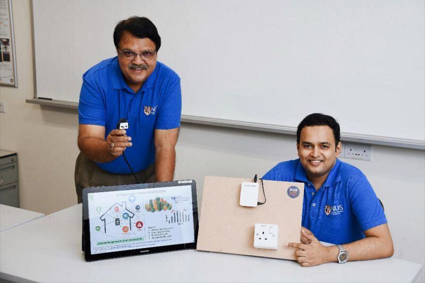 Associate Professor Sanjib Kumar Panda and Dr Krishnanand Kaippilly Radhakrishnan with a prototype of the smart socket system.