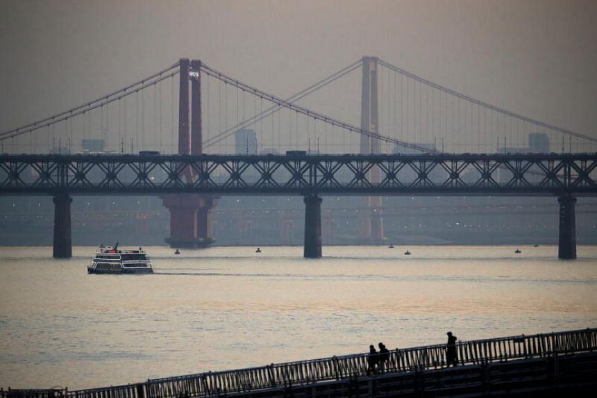 The dam built between the Poyang and the Yangtze River (above) will further harm an already fragile ecosystem.