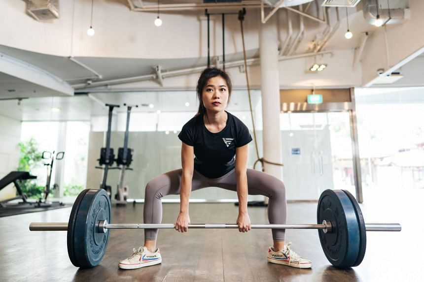 Freelance personal trainer Sharlynn Ooi's fitness routine is mostly powerlifting-based which includes deadlifts and squats.