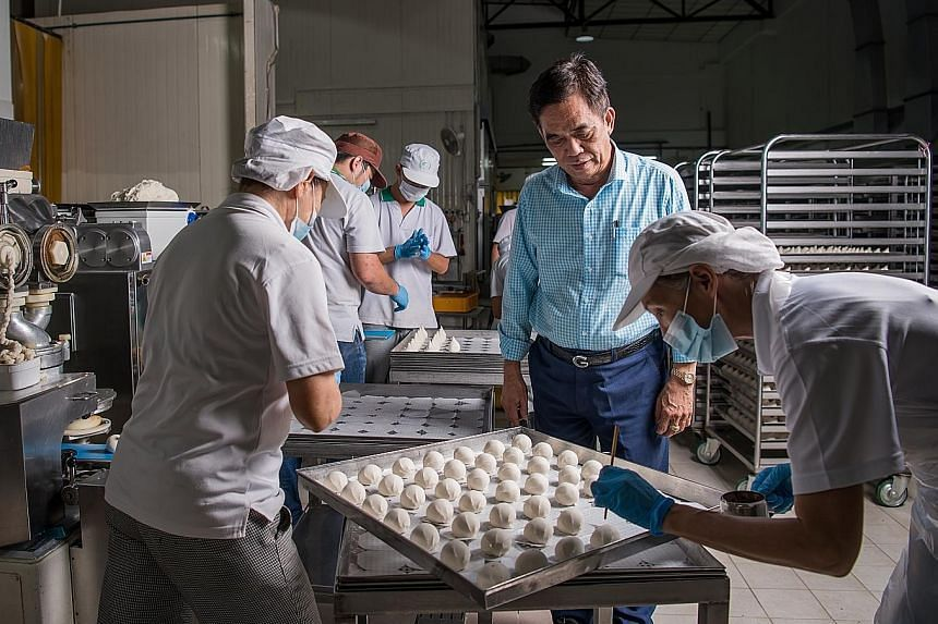 Workers making Chinese buns at Lim Kee Food Manufacturing's facility in Woodlands.