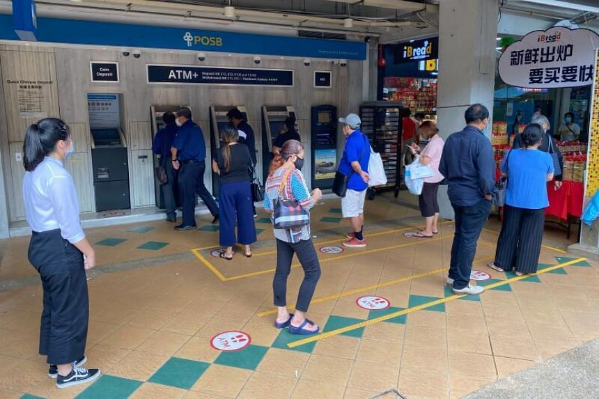 Long queues were seen outside some POSB ATMs as people stood in queue to collect new notes for Chinese New Year.