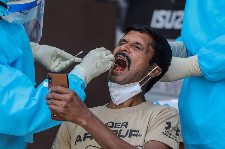 A man undergoes a Covid-19 swab test in Colombo, Sri Lanka, Jan 26, 2021.