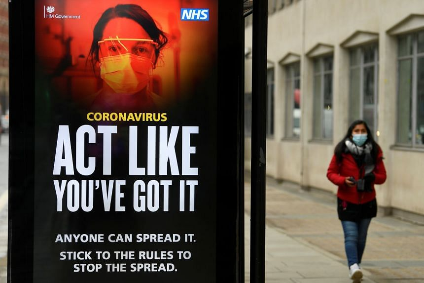 An official public health information poster is seen on a bus shelter in London, Britain, Jan 27, 2021.