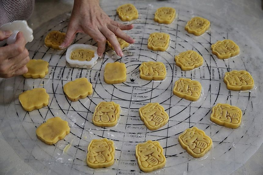 Mr Derick Goh, 40, started home bakery Dream Hearts last May during the circuit breaker period. The full-time home baker, who specialises in fortune cat-shaped pineapple tarts, said he has made sure he has enough ingredients to last through the festi