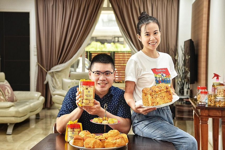 Mr Jonas Lim, 30, and his wife Soh Rui Yi, 28, who run home bakery Jo-Yi Bakery, with their Chinese New Year butter cookies, pineapple tarts and festive-themed bread. The couple have capped their daily orders at 20 to make sure they can cope with the