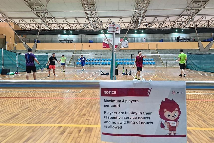 Recreational shuttlers playing badminton at Yishun Sports Hall. Many players have resorted to getting court time via third parties due to overwhelming demand.