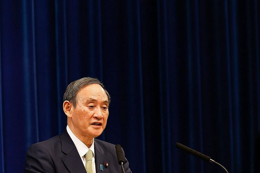 Japanese Prime Minister Yoshihide Suga speaking at a press conference earlier this month, where he announced that additional prefectures would go under a state of emergency amid a surge in Covid-19 cases. His leadership will be put to the test when t