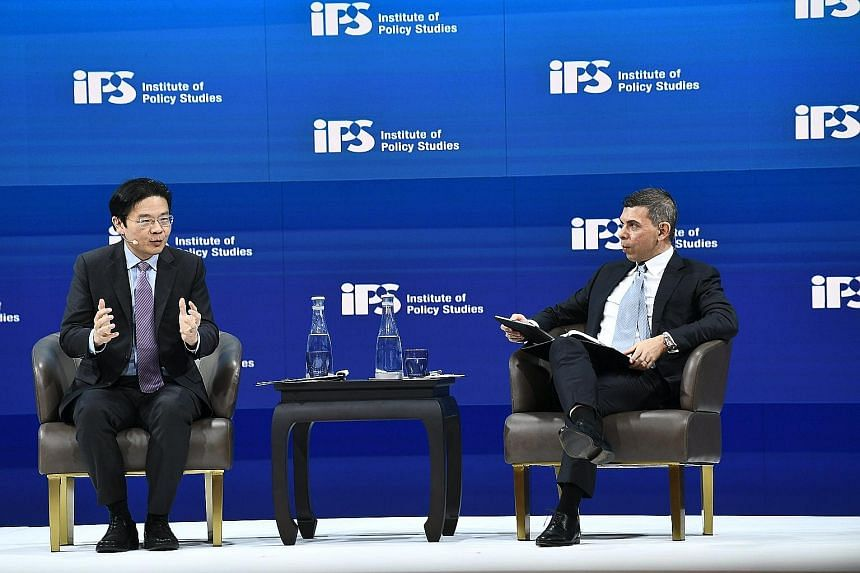 Education Minister Lawrence Wong speaking at a dialogue chaired by Straits Times editor Warren Fernandez as part of the Institute of Policy Studies' Singapore Perspectives conference yesterday.