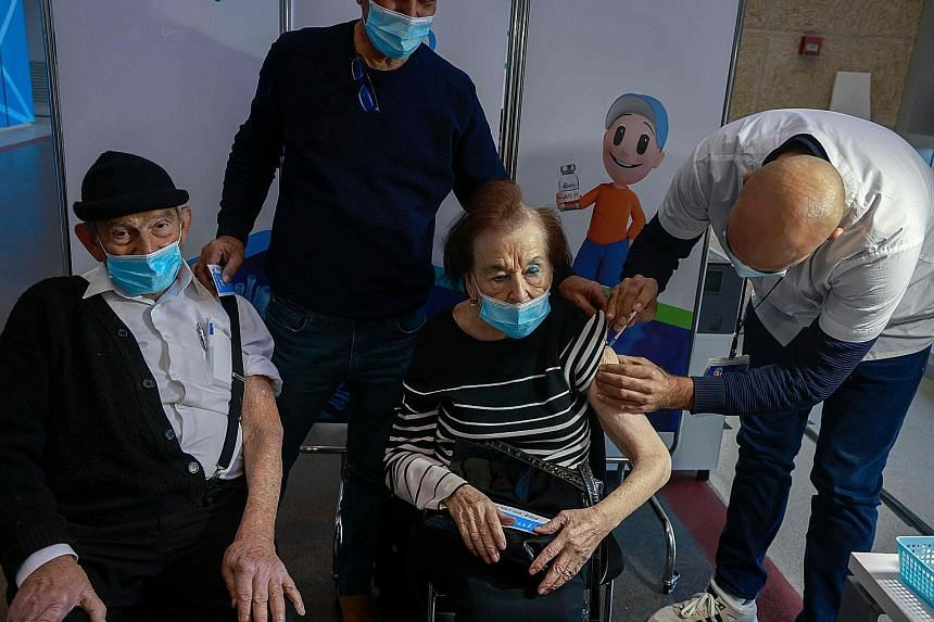 A woman receiving a dose of the Pfizer-BioNTech vaccine at Clalit Health Services in Jerusalem on Sunday. The Israeli Health Ministry found that out of 428,000 Israelis who had received their second doses, only 63 - or 0.014 per cent - contracted the