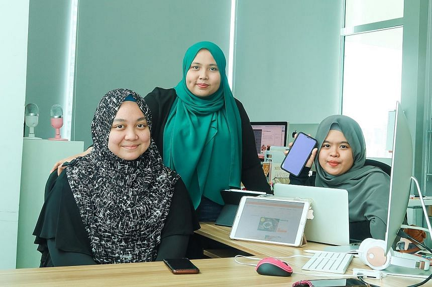 Halalfoodhunt chief executive and co-founder Jumaiyah Mahathir (centre), 31, flanked by managing assistant Nur Sarah Razali (left), 24, and sales executive Nur'Adriana Maisarah Abdul Rani, 21, at their office in Jalan Besar. In 2019, the company tapp