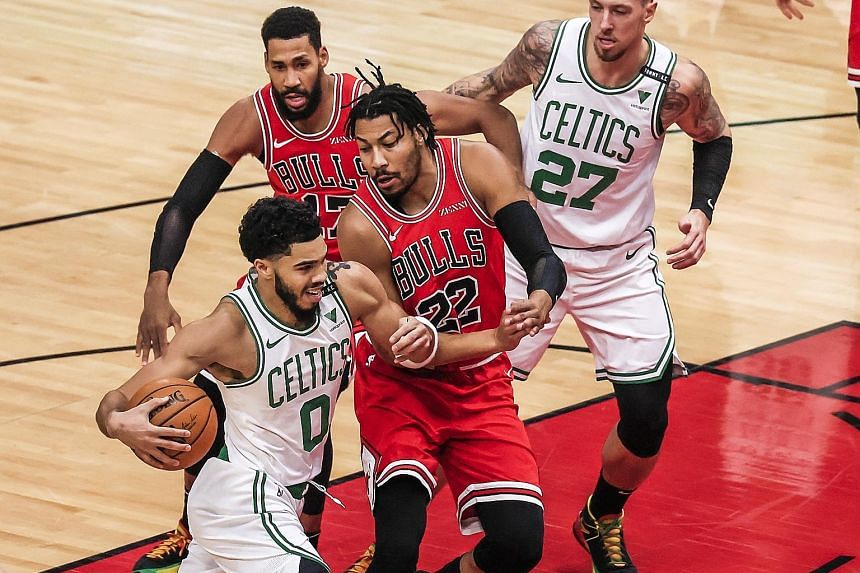 Boston forward Jayson Tatum driving past Chicago's Otto Porter Jr during the Celtics' 119-103 road victory on Monday. Tatum scored 24 points after recovering from Covid-19, which he described as a mentally tough experience.