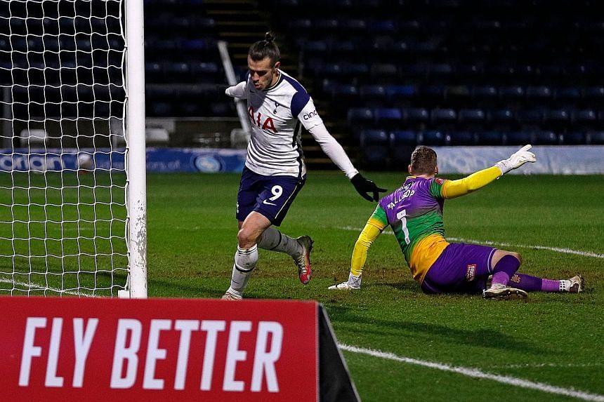 Gareth Bale celebrates nodding in Tottenham's equaliser against Championship side Wycombe. Spurs' 4-1 win earned them a trip to Goodison Park to play Everton in the fifth round of the FA Cup.