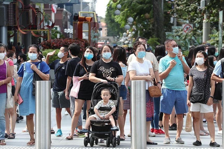 Wearing masks outdoors (above) and observing safe distancing are among the practices that many Singapore residents will keep to when the Covid-19 pandemic is over, according to a nationwide online study conducted last month by Nanyang Technological U