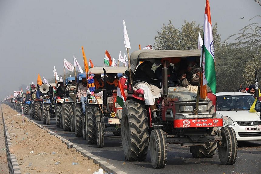 "Farmers on tractors staging their own Republic Day ""parade"" on routes designated for a peaceful rally on the border of New Delhi. However, some groups altered course and headed into the capital, where they breached barricades to enter the historic Re"