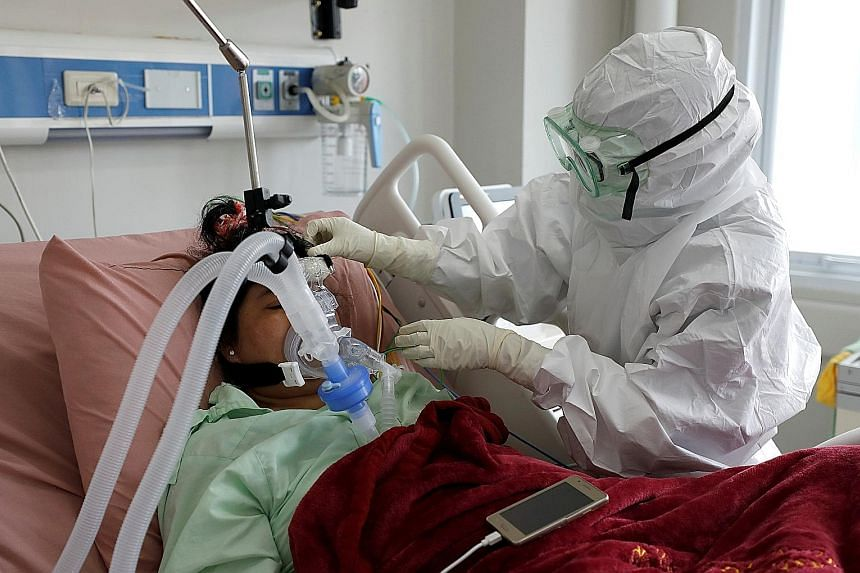A nurse attending to a patient in the intensive care unit of a hospital in Bogor, West Java province, yesterday.