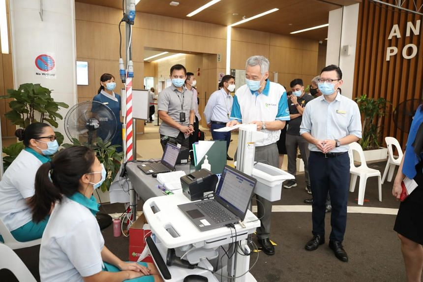 PM Lee during a visit to Ang Mo Kio Polyclinic on Jan 27, 2021.