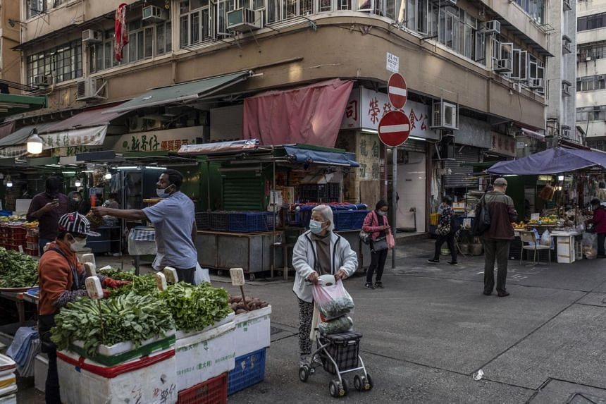 Shoppers at a market in Jordan, a working-class neighborhood in Hong Kong, on Jan 25, 2021.