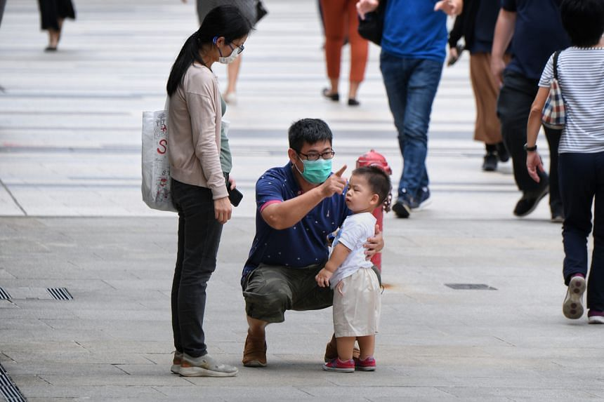 A father talking to his child as his wife looks on at Paya Lebar Central, on Sept 15, 2020.