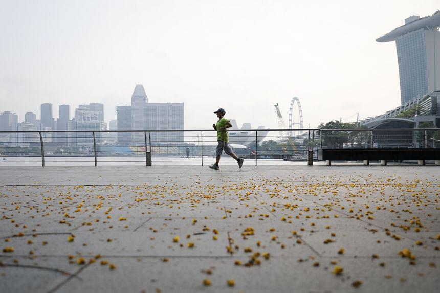 A runner jogging near The Promontory in Marina Bay area, on Aug 16, 2018.