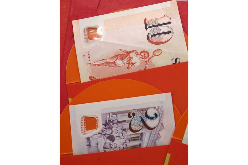 Ahead of Chinese New Year, new notes can be withdrawn from pop-up ATMs at designated community clubs, as well as selected existing ATMs. The writer was at Chong Pang Community Club to do so yesterday.